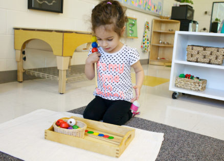 A toddler learning her colors in our Montessori toddler classroom.