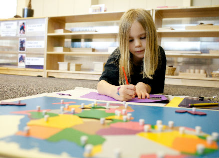 A student learning her geography in her Montessori kindergarten class