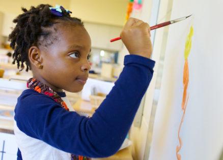 A student expressing her creativity through paint in best Montessori preschool